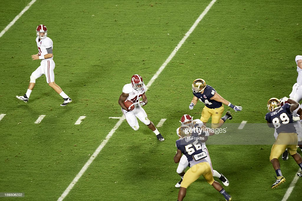 Alabama Eddie Lacy (42) in action, rushing vs Notre Dame at Sun Life Stadium. Bill Frakes F38 )