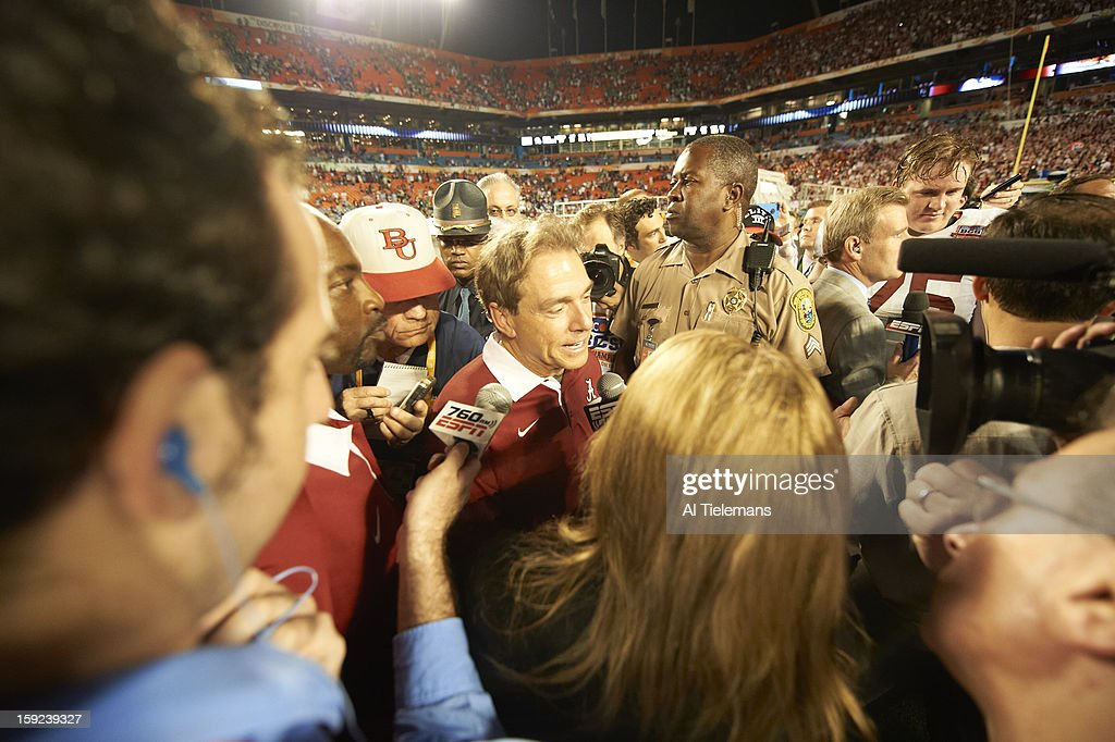 Alabama head coach Nick Saban victorious, giving media interview on field after winning game vs Notre Dame at Sun Life Stadium. Al Tielemans F2 )