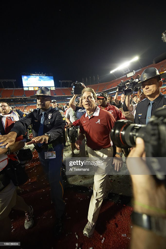 Alabama head coach Nick Saban victorious on field after winning game vs Notre Dame at Sun Life Stadium. Al Tielemans F23 )