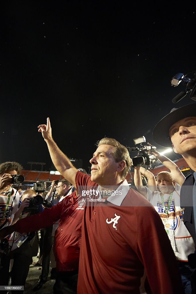 Alabama head coach Nick Saban victorious on field after winning game vs Notre Dame at Sun Life Stadium. Al Tielemans F33 )