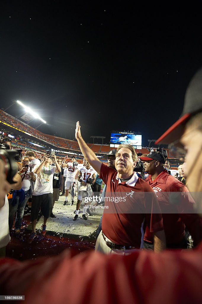 Alabama head coach Nick Saban victorious on field after winning game vs Notre Dame at Sun Life Stadium. Al Tielemans F44 )