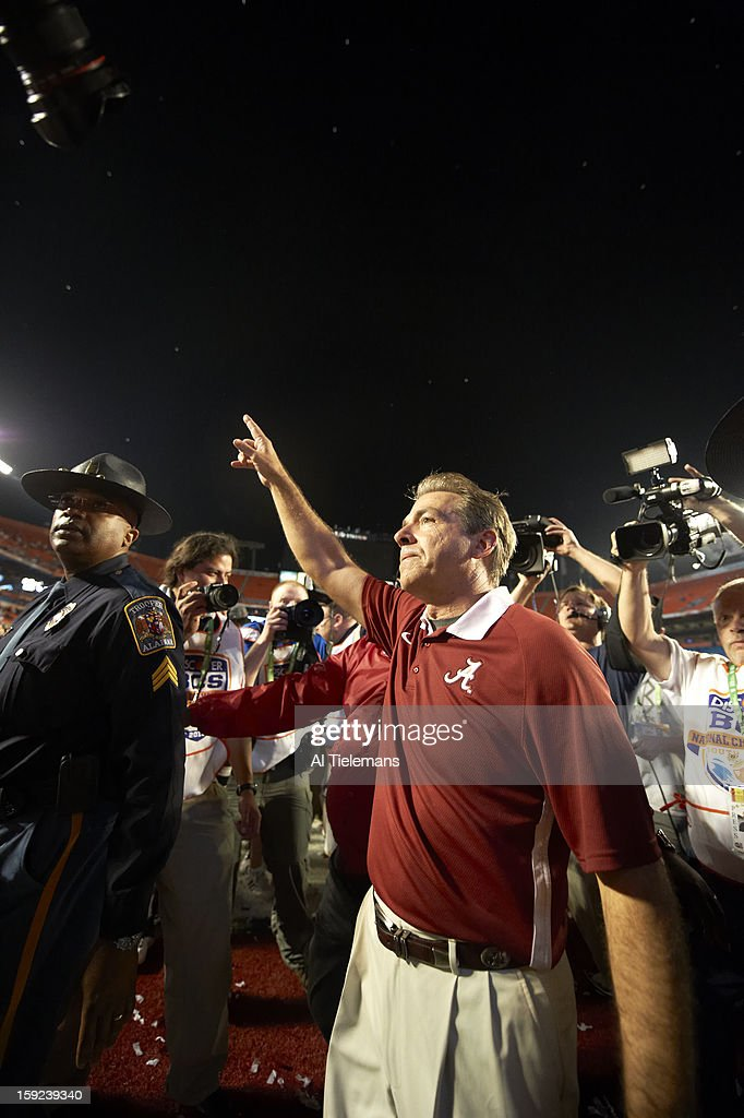 Alabama head coach Nick Saban victorious on field after winning game vs Notre Dame at Sun Life Stadium. Al Tielemans F36 )