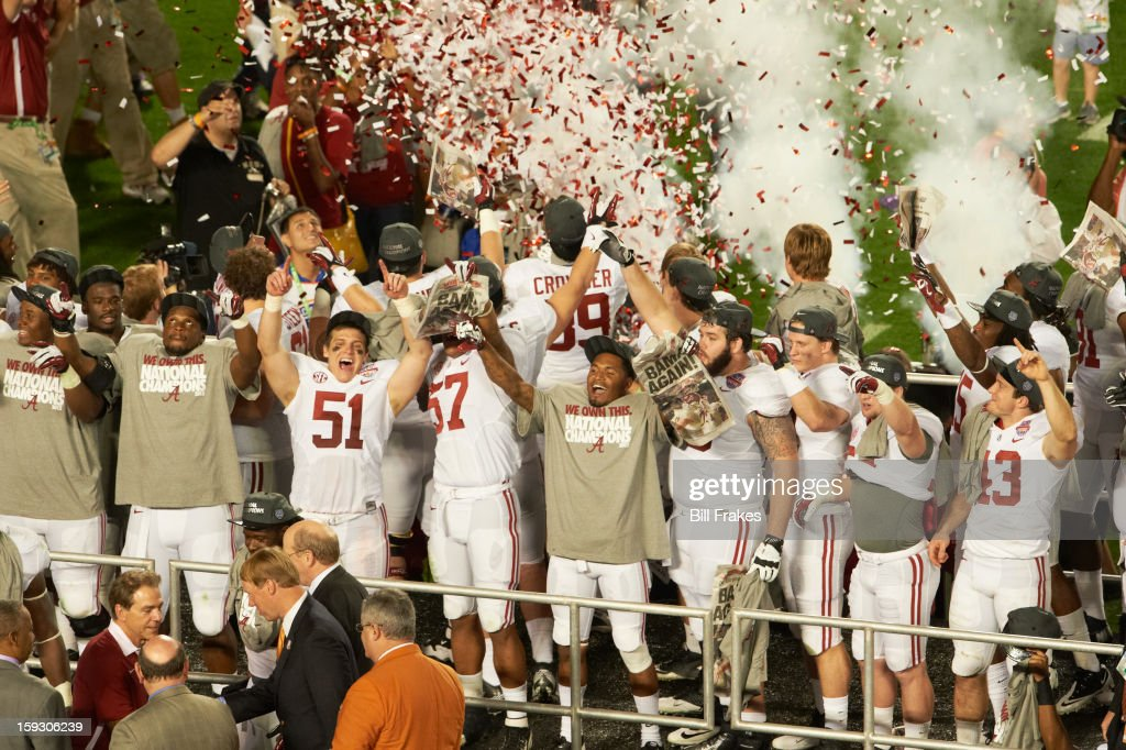 Alabama players victorious after winning game vs Notre Dame at Sun Life Stadium. Bill Frakes F108 )