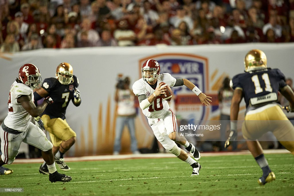 Alabama QB A.J. McCarron (10) in action, rushing vs Notre Dame at Sun Life Stadium. Al Tielemans F46 )