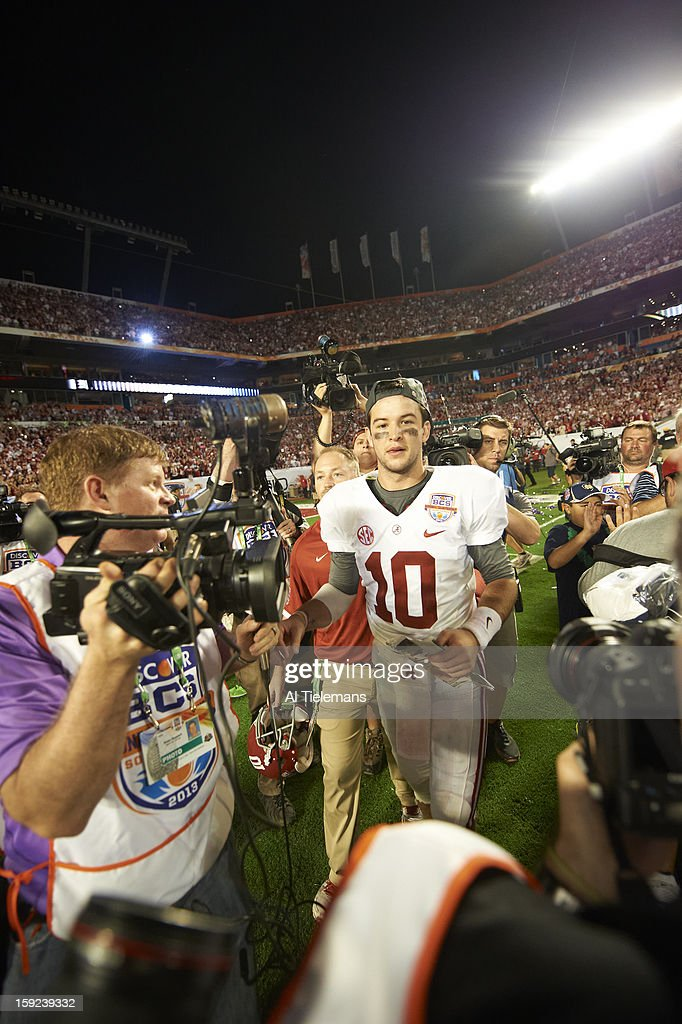 Alabama QB A.J. McCarron (10) victorious on field after winning game vs Notre Dame at Sun Life Stadium. Al Tielemans F100 )