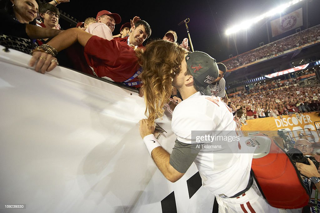 Alabama QB A.J. McCarron (10) victorious, kissing girlfriend Katherine Webb after winning game vs Notre Dame at Sun Life Stadium. Al Tielemans F57 )