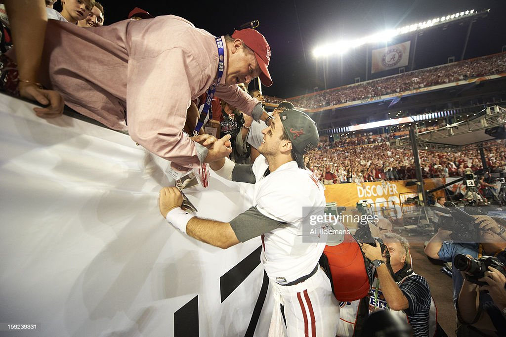 Alabama QB A.J. McCarron (10) victorious with his father, Tony McCarron, after winning game vs Notre Dame at Sun Life Stadium. Al Tielemans F52 )