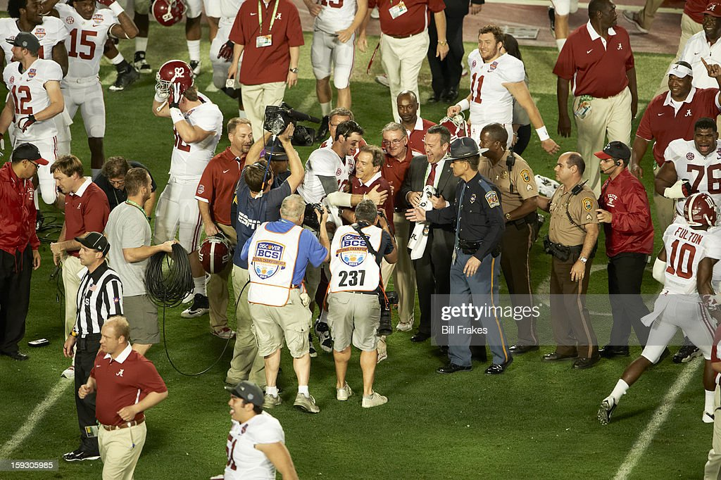 Alabama QB AJ McCarron (10) victorious, hugging coach Nick Saban after winning game vs Notre Dame at Sun Life Stadium. Bill Frakes F38 )