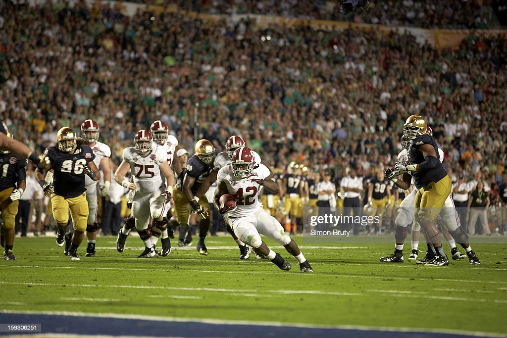 Alabama T.J. Yeldon (4) in action, rushing vs Notre Dame at Sun Life Stadium. Simon Bruty F2 )