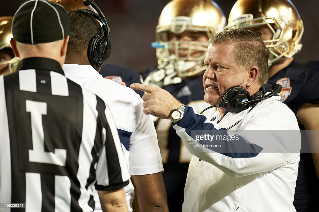 Closeup of Notre Dame head coach Brian Kelly on field during game vs Alabama at Sun Life Stadium. Al Tielemans F14 )
