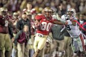 BCS National Championship Florida State Rashad Greene in action after making catch vs Auburn Ryan White during 4th quarter at Rose Bowl Stadium...