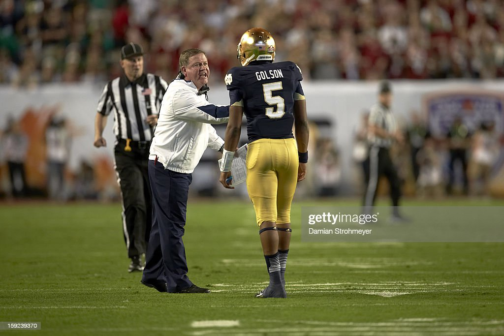Notre Dame coach Brian Kelly on field with QB Everett Golson (5) during game vs Alabama at Sun Life Stadium. Damian Strohmeyer F61 )