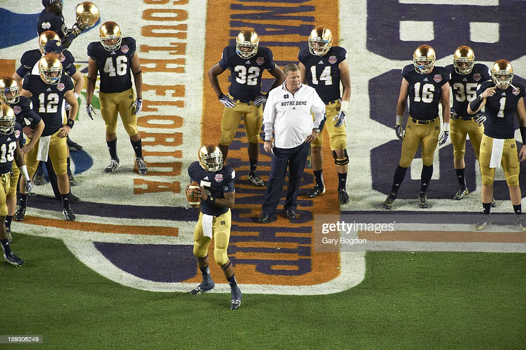 Notre Dame coach Brian Kelly with players on field before game vs Alabama at Sun Life Stadium. Gary Bogdon F72 )