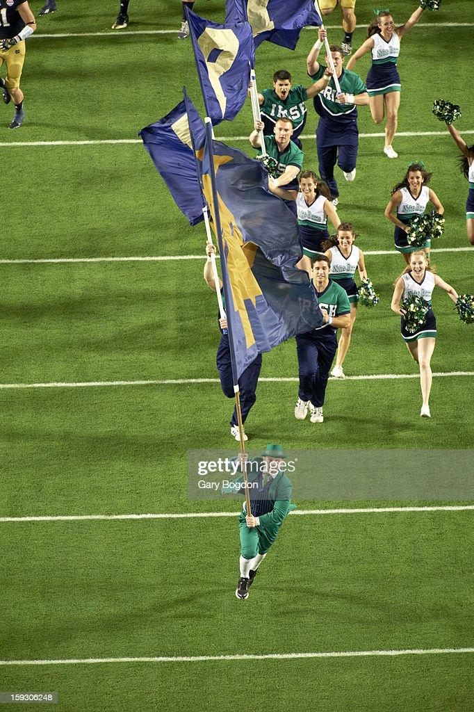 Notre Dame mascot and cheerleaders taking field before game vs Alabama at Sun Life Stadium. Gary Bogdon F120 )