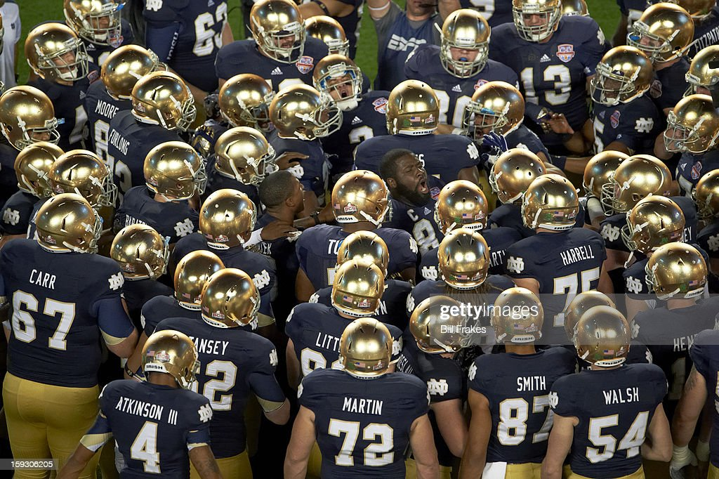 Notre Dame players in huddle before game vs Alabama at Sun Life Stadium. Bill Frakes F27 )