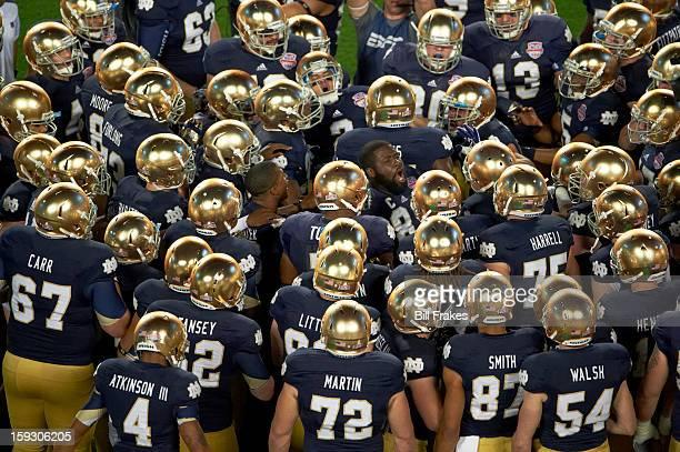 BCS National Championship Notre Dame players in huddle before game vs Alabama at Sun Life Stadium Miami Gardens FL CREDIT Bill Frakes
