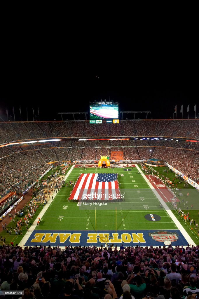 Overall view of national flag unfurled on field before Alabama vs Notre Dame game at Sun Life Stadium. Gary Bogdon F59 )