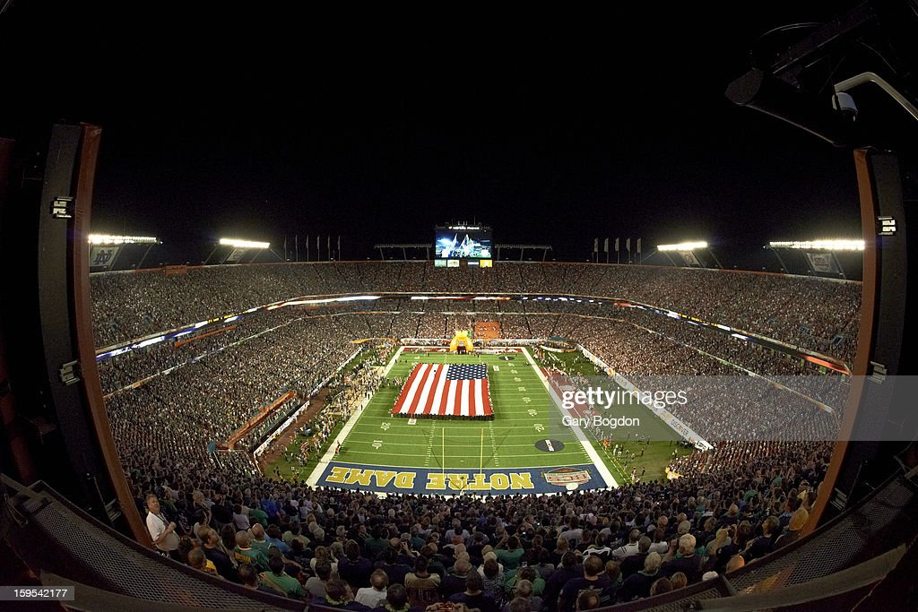 Overall view of national flag unfurled on field before Alabama vs Notre Dame game at Sun Life Stadium. Gary Bogdon F27 )