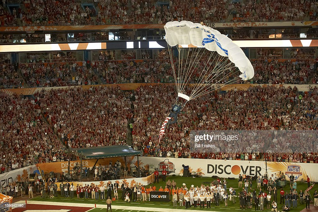 View of parachuter over field before Alabama vs Notre Dame game at Sun Life Stadium. Bill Frakes F61 )
