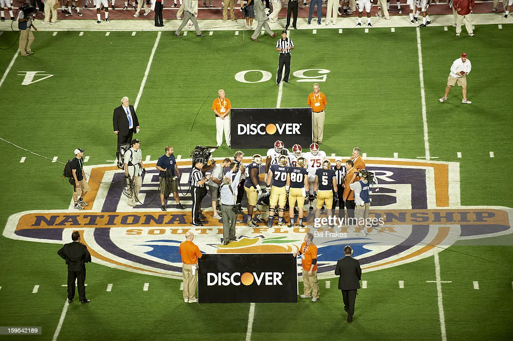 View of team captains meeting on field before start of Alabama vs Notre Dame game at Sun Life Stadium. Bill Frakes F96 )