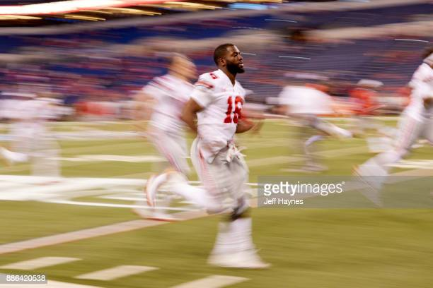 Big 10 Championship Blurred view of Ohio State QB JT Barrett warming up before game vs Wisconsin at Lucas Oil Stadium Indianapolis IN CREDIT Jeff...