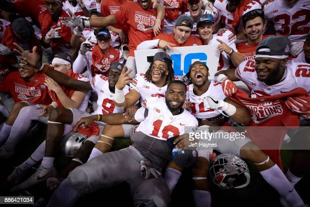 Big 10 Championship Ohio State QB JT Barrett victorious with teammates on field after winning game vs Wisconsin at Lucas Oil Stadium Indianapolis IN...