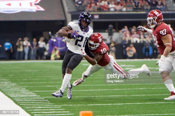 Big 12 Championship Texas Christian Kyle Hicks in aciton rushing vs Oklahoma Steven Parker at ATT Stadium Dallas TX CREDIT Greg Nelson