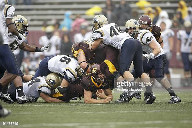 Central Michigan QB Dan LeFevour in action during tackle by Akron Hasan Hazime Brian Wagner and Jeff Maddux Mount Pleasant MI 9/26/2009 CREDIT Andrew...