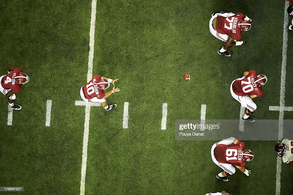 Aerial view of Alabama QB AJ McCarron (10) in action, taking snap vs Virginia Tech at Georgia Dome. Pouya Dianat F32 )