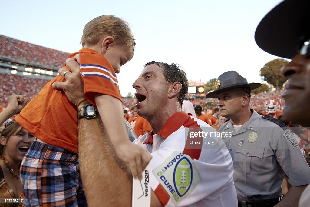 Clemson coach Dabo Swinney victorious with son after winning game vs Florida State at Memorial Stadium. Simon Bruty F106 )