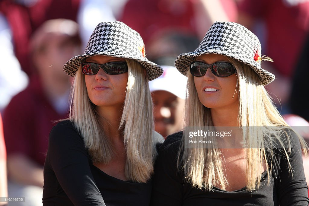 Closeup of Alabama female fans wearing houndstooth hats in stands during game vs Louisiana State at BryantDenny Stadium Tuscaloosa AL CREDIT Bob...