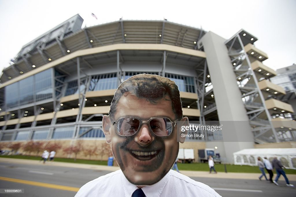 Closeup of fan dressed as former Penn State coach Joe Paterno outside stadium before game vs Ohio State at Beaver Stadium. Simon Bruty F58 )