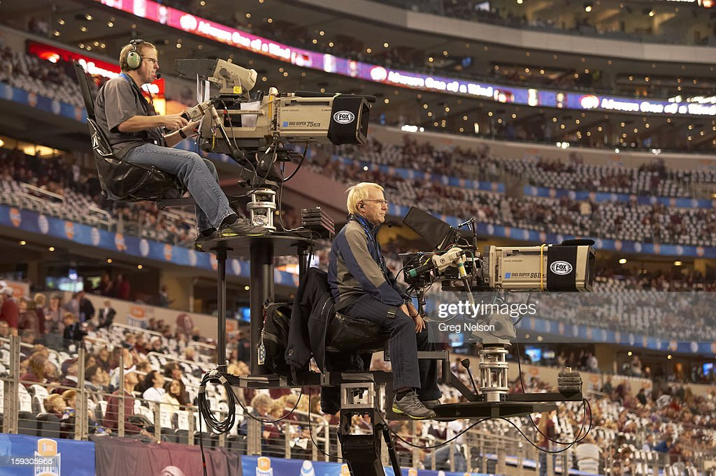 View of television cameras with cameramen on perch during Texas A&M vs Oklahoma game at Cowboys Stadium. Greg Nelson F2 )