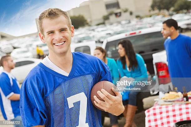 College football fan at stadium tailgate party with friends