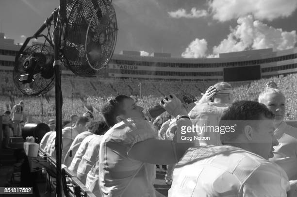 Infrared view of Oklahoma State Dayton Metcalf drinking from bottle on bench during game vs Texas Christian at Boone Pickens Stadium Stillwater OH...