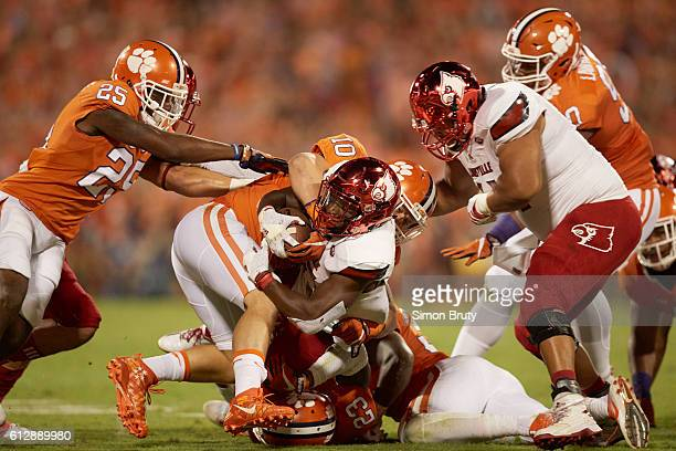 Louisville Brandon Radcliff in action rushing vs Clemson Ben Boulware Van Smith Cordrea Tankersley and Kendall Joseph at Memorial Stadium Clemson SC...