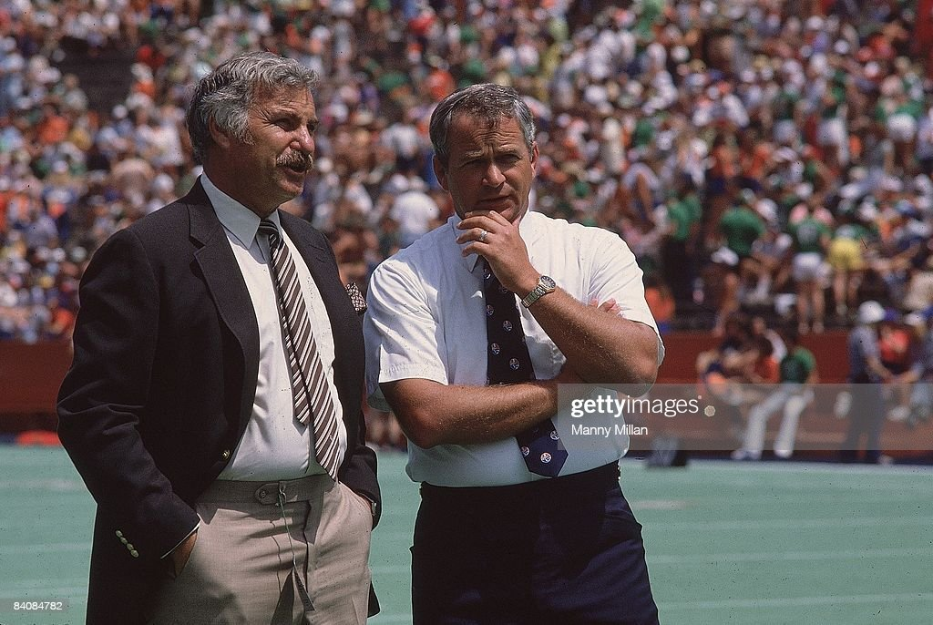 Miami head coach Howard Schnellenberger and Florida head coach Charley Pell during game Gainesville FL 9/4/1982 CREDIT Manny Millan