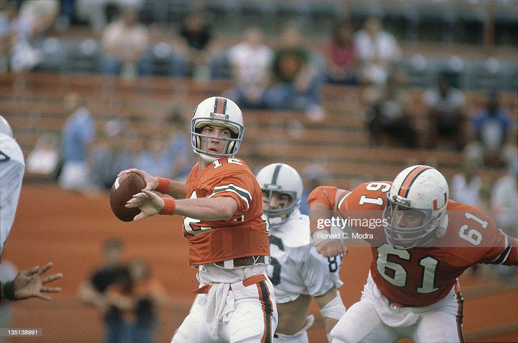 Miami QB Jim Kelly (12) in action vs Penn State at the Orange Bowl Stadium. Ronald C. Modra R24 )