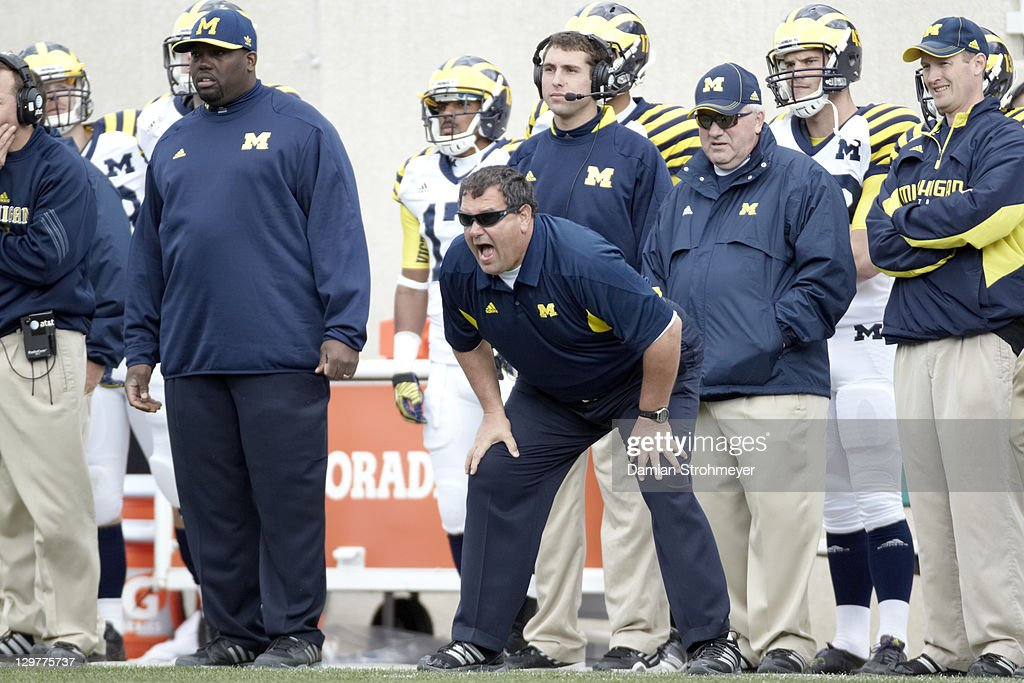 Michigan coach <a gi-track='captionPersonalityLinkClicked' href=/galleries/search?phrase=Brady+Hoke&family=editorial&specificpeople=3821056 ng-click='$event.stopPropagation()'>Brady Hoke</a> on sidelines during game vs Michigan State at Spartan Stadium. Damian Strohmeyer F324 )
