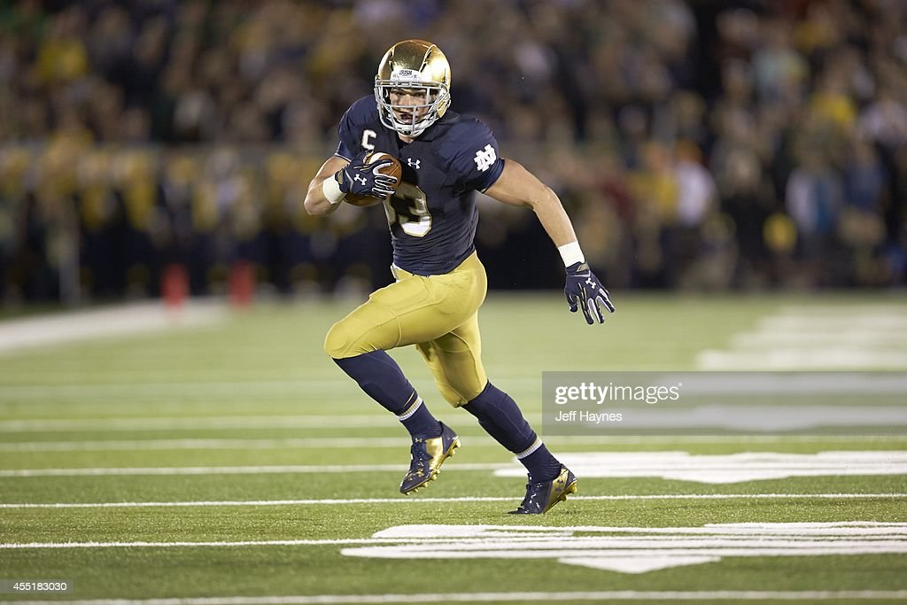 Notre Dame <a gi-track='captionPersonalityLinkClicked' href=/galleries/search?phrase=Cam+McDaniel&family=editorial&specificpeople=9937391 ng-click='$event.stopPropagation()'>Cam McDaniel</a> (33) in action, rushing vs Michigan at Notre Dame Stadium. Jeff Haynes TK1 )