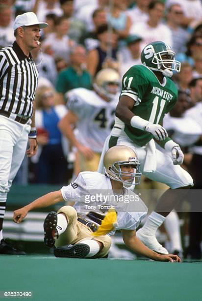Notre Dame Reggie Ho down on field after kick vs Michigan State at Spartan Stadium Yellow penalty flag hitting field East Lansing MI CREDIT Tony...