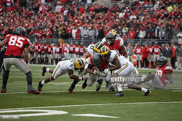 Ohio State QB JT Barrett in action vs Michigan Delano Hill Jabrill Peppers and Chris Wormley at Ohio Stadium Columbus OH CREDIT Jeff Haynes