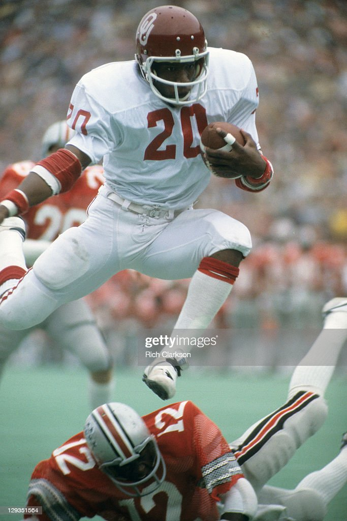 Oklahoma <a gi-track='captionPersonalityLinkClicked' href=/galleries/search?phrase=Billy+Sims&family=editorial&specificpeople=541482 ng-click='$event.stopPropagation()'>Billy Sims</a> (20) in action, jumping over Ohio State Mike Guess (12) at Ohio Stadium. Cover. Rich Clarkson X21778 )