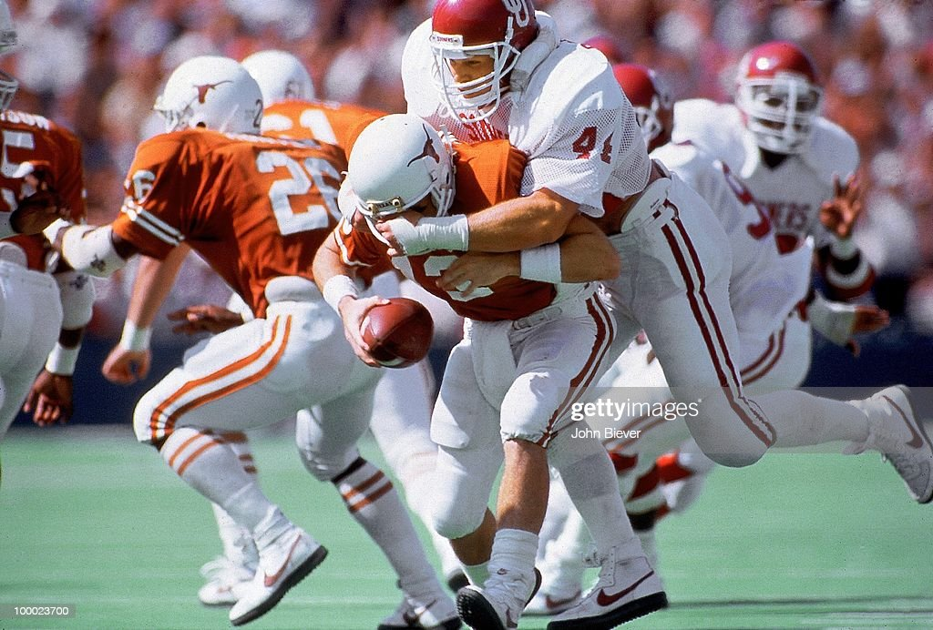 Oklahoma Brian Bosworth (44) in action, sack vs Texas QB Todd Dodge (13). Dallas, TX