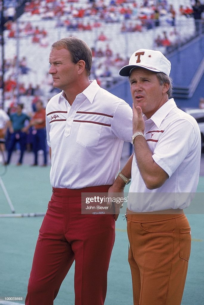 Oklahoma coach Barry Switzer with Texas coach Fred Akers on field before game. Dallas, TX