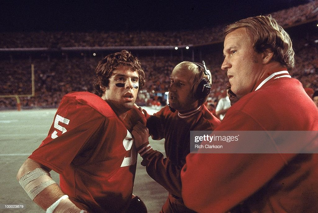 Oklahoma coach Barry Switzer on sidelines with QB Steve Davis (5) during game vs Michigan. Miami, FL 1/1/1976