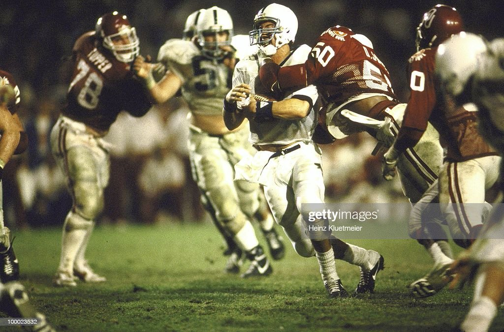 Oklahoma Dante Jones (50) in action, making sack vs Penn State QB Paul Shaffer (14). Miami, FL 1/1/1986