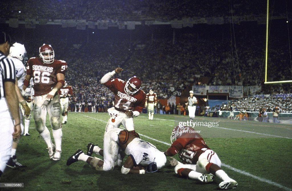 Oklahoma Derrick White (14) and Troy Johnson (80) victorious on field after making hit vs Penn State D.J. Dozier (42). Miami, FL 1/1/1986