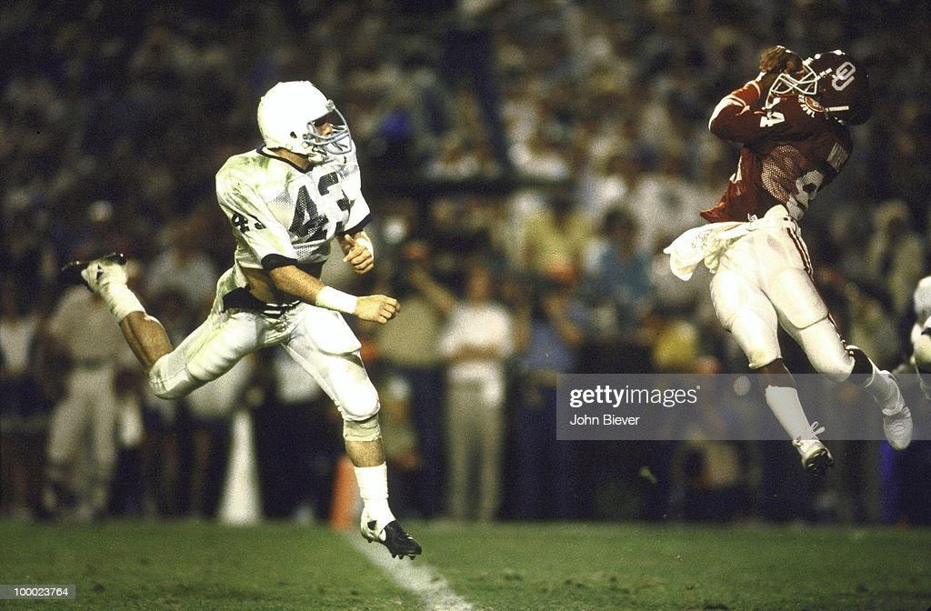 Oklahoma Lee Morris (84) in action, attempting catch vs Penn State Mike Zordich (43). Incomplete. Miami, FL 1/1/1986