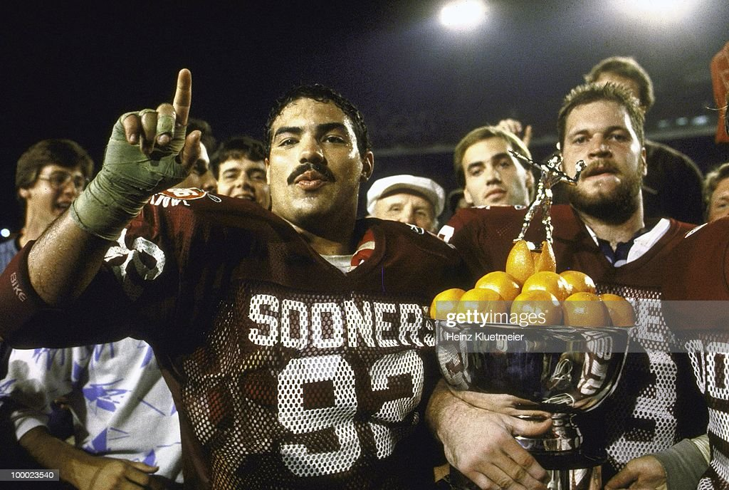 Oklahoma Tony Casillas (92) victorious with teammates and trophy after winning National Championship game vs Penn State. Miami, FL 1/1/1986